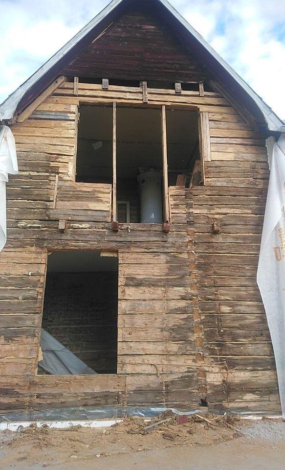 Isolering utsida vägg på timmerhus i Boden 1